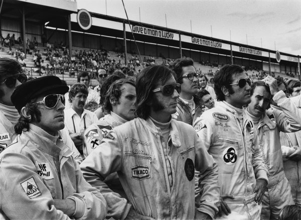 Kyalami, South Africa. 3rd March 1973.Francois Cevert, Jackie Stewart, Niki Lauda, Emerson Fittipaldi, Carlos Pace and Clay Reggazoni at the drivers briefing, portrait.  World Copyright: LAT Photographic.Ref:  5107 - 16A.