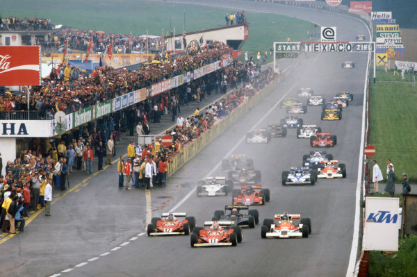 Osterreichring, Zeltweg, Austria. 12th - 14th August 1977. Niki Lauda (Ferrari 312T2) leads James Hunt (McLaren M26 Ford), Carlos Reutemann (Ferrari 312T2) and Mario Andretti (Lotus Ford) at the start of the race, action.  World Copyright: LAT Photographic. Ref: 77 AUT 10.