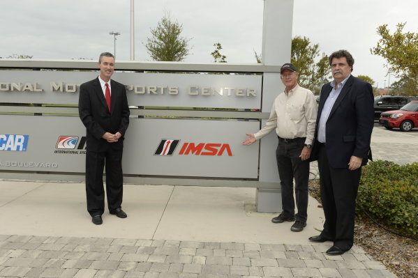 19-20 November, 2013, Daytona Beach, Florida Jim France, Ed Bennett, and Mike Helton unveil the new IMSA sign at International Motorsports Center in Daytona Beach, FL @2013 Richard Dole LAT Photo USA