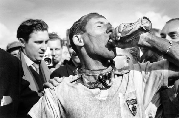 1957 British Grand Prix.Aintree, Great Britain. 18-20 July 1957.Stirling Moss (Vanwall), 1st position, takes a victory drink of Coca-Cola after he and Tony Brooks won the first World Championship grand prix by a British car.World Copyright: LAT PhotographicRef: Motor 7495C #23/A Race Through Time exhibition #28/MotorSport calendar