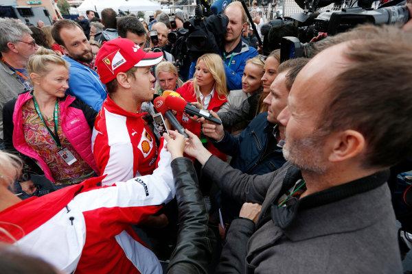 Monte Carlo, Monaco. Thursday 21 May 2015. Sebastian Vettel, Ferrari, talks to the media. World Copyright: Alastair Staley/LAT Photographic. ref: Digital Image _79P0303
