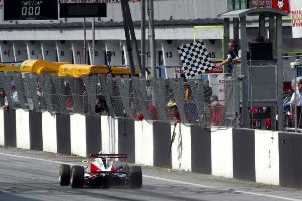 Ryan Briscoe (AUS) Prema Powerteam Dallara Opel crosses the line to win the race.
