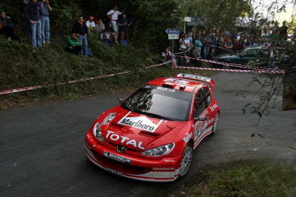 2003 FIA World Rally Champs. Round Eleven Sanremo Rally 2nd-5th October 2003.Richard Burns, Peugeot, action. World Copyright: McKlein/LAT