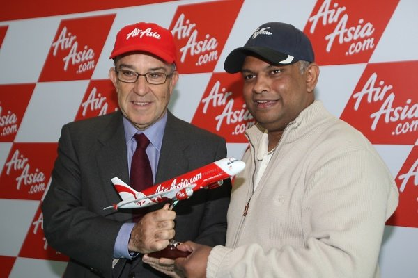 L-R: Carmelo Ezpeleta (ESP) CEO Dorna Sports S.L. is presented with the model of an AirAsia airline by Tony Fernandes (MAL), CEO AirAsia Group.AirAsia Signs As Title Sponsor for 2010 MotoGP British Grand Prix, Silverstone, England, Wednesday 10 February 2010.