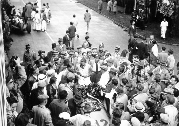1938 Swiss Grand Prix.  Bremgarten, Berne, Switzerland. 21 August 1938.  Rudolf Caracciola, Mercedes-Benz W154, 1st position, and Dick Seaman, Mercedes-Benz W154, 2nd position, in parc ferme after the race.  Ref: RF38_SWI_56. World Copyright: Robert Fellowes/LAT Photographic