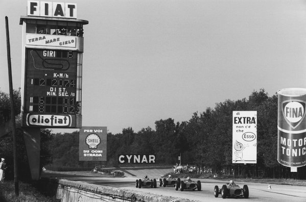 Monza, Italy. 8-10 September 1961. Four Ferrari Dino's 156 race down the main straight, action.  World Copyright: LAT Photographic. Ref:  L1158 - 23.