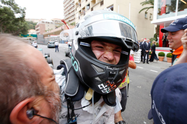 Monte Carlo, Monaco. Sunday 25 May 2014. Nico Rosberg, Mercedes AMG, 1st Position, celebrates with his team in Parc Ferme. World Copyright: Charles Coates/LAT Photographic. ref: Digital Image _J5R3925