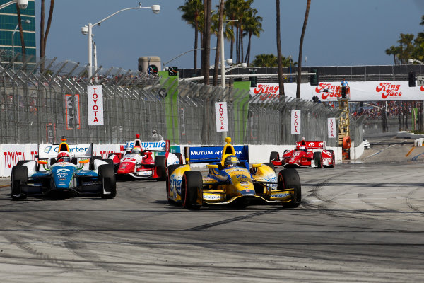 11-13 April, 2014, Long Beach, California USA Marco Andretti passes Simon Pagenaud ©2014, Phillip Abbott LAT Photo USA