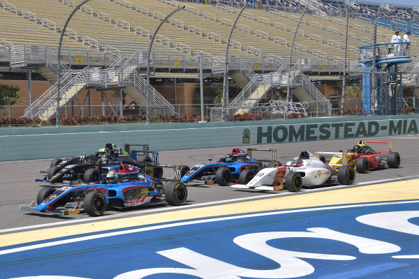 2017 F4 US Championship Rounds 1-2-3 Homestead-Miami Speedway, Homestead, FL USA Sunday 9 April 2017 Mad scramble for postion heading into turn one with #26 Sam Paley heading the pack of cars World Copyright: Dan R. Boyd/LAT Images
