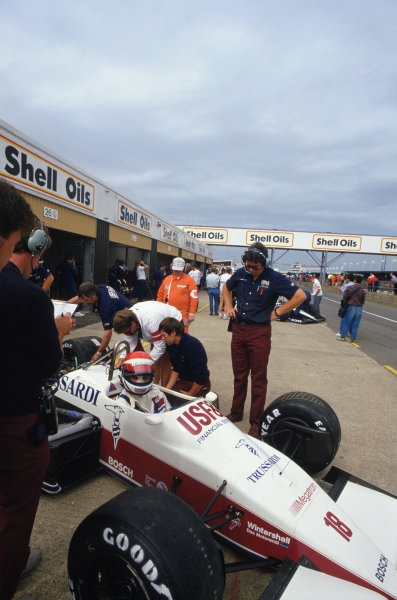 Silverstone, England. 10 - 12 July 1987.Eddie Cheever (Arrows A10-Megatron), retired, Chief Designer, Ross Brawn overlooks the action in the pits, portrait.World Copyright: LAT Photographic.Ref: 35mm Colour Transparency