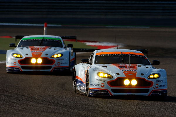 2015 FIA World Endurance Championship Bahrain 6-Hours Bahrain International Circuit, Bahrain Saturday 21 November 2015. Francesco Castellacci, Roald Goethe, Stuart Hall (#96 GTE AM Aston Martin Racing Aston Martin Vantage V8) leads Paul Dalla Lana, Pedro Lamy, Mathias Lauda (#98 GTE AM Aston Martin Racing Aston Martin Vantage V8). World Copyright: Alastair Staley/LAT Photographic ref: Digital Image _79P0213