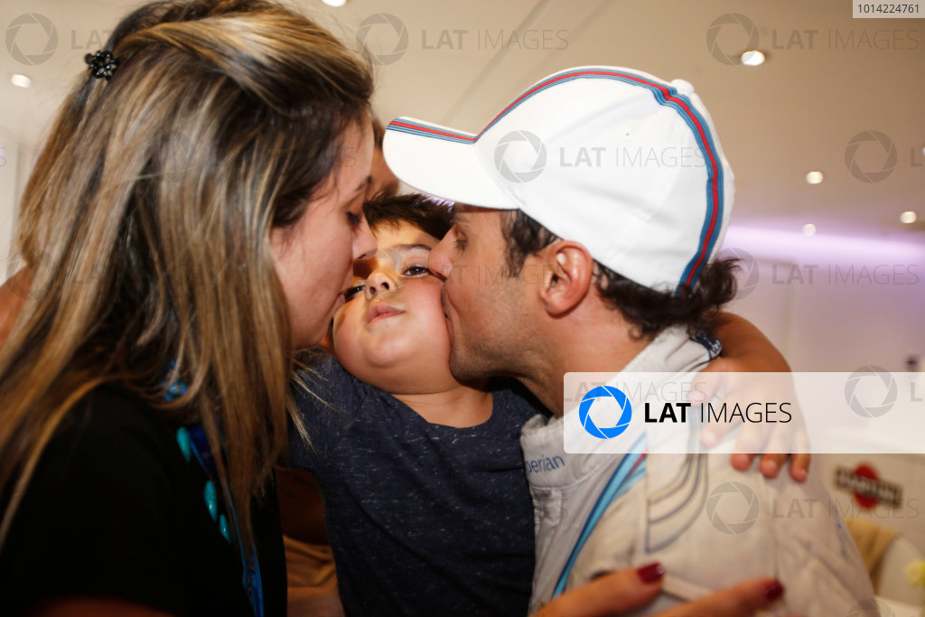Autodromo Nazionale di Monza, Monza, Italy. Sunday 7 September 2014. Felipe Massa, Williams F1, 3rd Position, celebrates with his wife and son. World Copyright: Glenn Dunbar/LAT Photographic. ref: Digital Image _W2Q0827