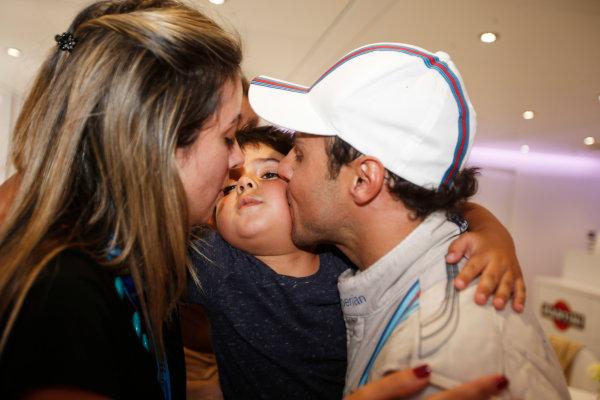 Autodromo Nazionale di Monza, Monza, Italy. Sunday 7 September 2014. Felipe Massa, Williams F1, 3rd Position, celebrates with his wife and son. World Copyright: Glenn Dunbar/LAT Photographic. ref: Digital Image _W2Q0827