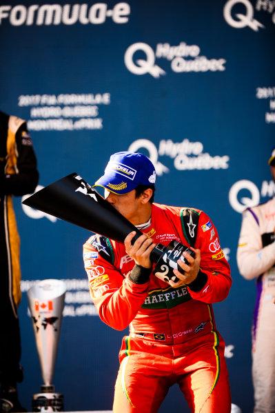 2016/2017 FIA Formula E Championship. Round 12 - Montreal ePrix, Canada Sunday 30 July 2017. Lucas Di Grassi (BRA), ABT Schaeffler Audi Sport, Spark-Abt Sportsline, ABT Schaeffler FE02, celebrates on the podium. Photo: Patrik Lundin/LAT/Formula E ref: Digital Image PL2_1470