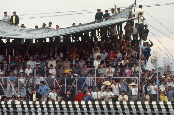 1968 Mexican Grand Prix.  Mexico City, Mexico. 1st-3rd November 1968.  Fans watch from in (and on) a grandstand.  Ref: 68MEX84. World Copyright: LAT Photographic