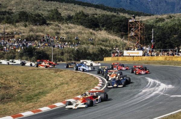 James Hunt, McLaren M26 Ford leads Jody Scheckter, Wolf WR1 Ford and Jochen Mass, McLaren M26 Ford.