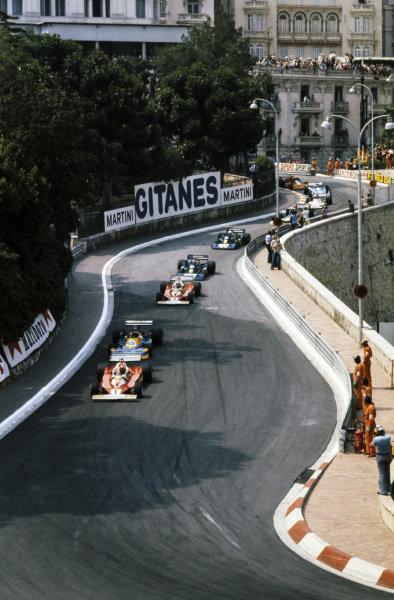 Niki Lauda, Ferrari 312T2 leads Ronnie Peterson, March 761 Ford and Clay Regazzoni, Ferrari 312T2.