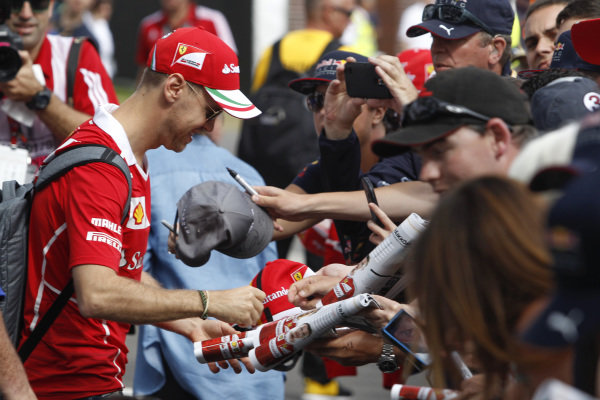 Sebastian Vettel (GER) Ferrari signs autographs ofr the fans at Formula One World Championship, Rd1, Australian Grand Prix, Race, Albert Park, Melbourne, Australia, Sunday 26 March 2017.