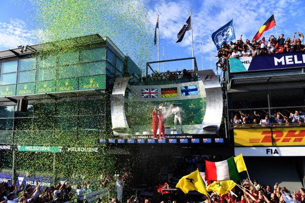 Lewis Hamilton (GBR) Mercedes AMG F1, Luigi Fraboni (ITA) Ferrari Head of Engine Trackside Operations, race winner Sebastian Vettel (GER) Ferrari and Valtteri Bottas (FIN) Mercedes AMG F1 celebrate on the podium with the champagne at Formula One World Championship, Rd1, Australian Grand Prix, Race, Albert Park, Melbourne, Australia, Sunday 26 March 2017.