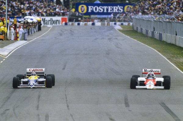 Keke Rosberg, McLaren MP4-2C TAG, sparks as he battles Nelson Piquet, Williams FW11 Honda.