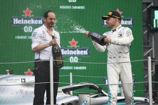 Valtteri Bottas, Mercedes AMG F1, 3rd position, sprays Champagne on the podium