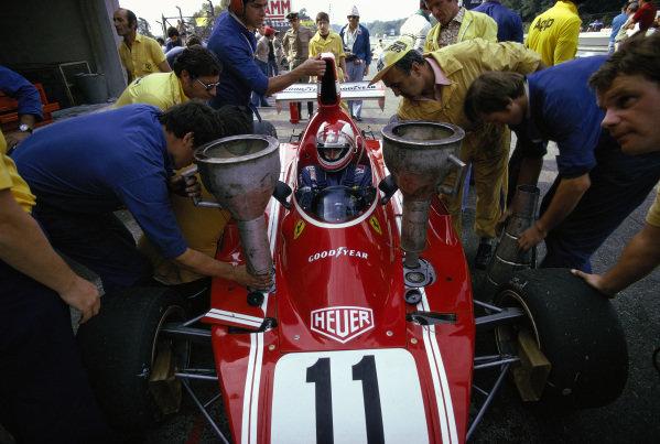 Clay Regazzoni sits in his Ferrari 312B3 as it is refuelled.