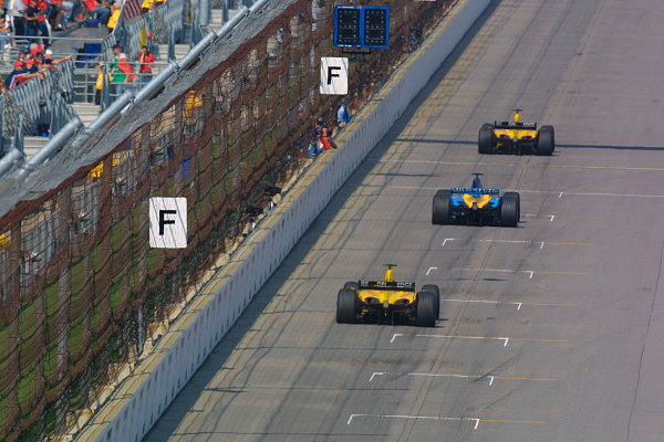 2002 American Grand Prix.Indianapolis, Indiana, USA. 27-29 September 2002.Giancarlo Fisichella (Jordan EJ12 Honda), followed by Jenson Button (Renault R202) and Takuma Sato (Jordan EJ12 Honda).World Copyright - LAT Photographicref: Digital File Only