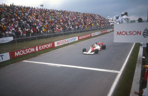 1990 Canadian Grand Prix.Montreal, Canada.8-10 June 1990.Ayrton Senna (McLaren MP4/5B Honda) celebrates his 1st position on taking the chequered flag.Ref-90 CAN 03.World Copyright - LAT Photographic