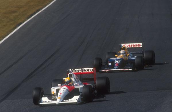 1991 Japanese Grand Prix.Suzuka, Japan.18-20 October 1991.Ayrton Senna (McLaren MP4/6 Honda) followed by Nigel Mansell (Williams FW14 Renault). Senna came 2nd and Mansell failed to finish.Ref-91 JAP 01.World Copyright - LAT Photographic