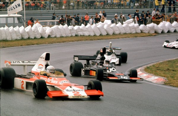 1975 Dutch Grand Prix. Zandvoort, Holland. 20-22 June 1975. Jochen Mass (McLaren M23 Ford) leads Tom Pryce (Shadow DN5A Ford). World Copyright - LAT Photographic Ref: 75HOL34