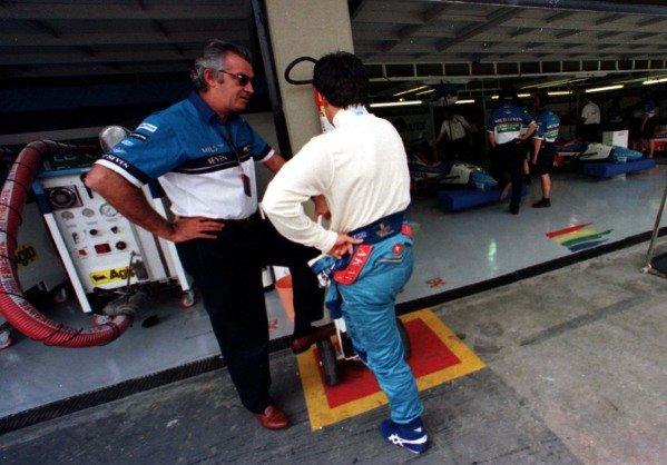 1997 Brazilian Grand Prix.Interlagos, Sao Paulo, Brazil.28-30 March 1997.Benetton Renault team principal Flavio Briatore talks to Jean Alesi.World Copyright - LAT Photographic