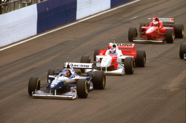 Silverstone, England.12-14 July 1996.Jacques Villeneuve (Williams FW18 Renault) 1st position followed by Mika Hakkinen (McLaren MP4/11 Mercedes) and Michael Schumacher (Ferrari F310).Ref-96 GB 08.World Copyright - LAT Photographic