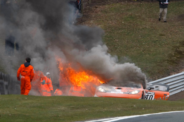 2013 Avon Tyres British GT Championship, Oulton Park, Cheshire. 30th March - 1st April 2013. The car of Colin White IDL - CWS Ginetta G55 GT3 catches fire. World Copyright: Ebrey / LAT Photographic.