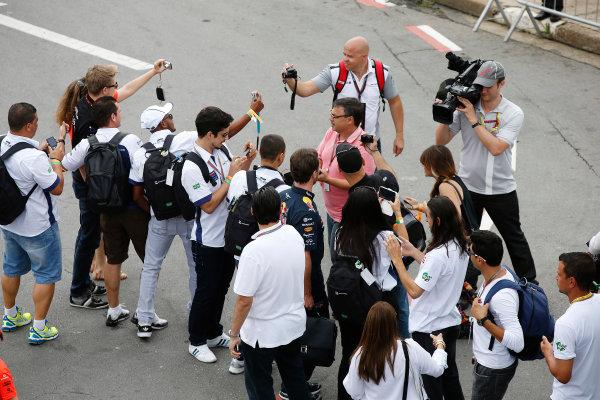 Interlagos, Sao Paulo, Brazil. Sunday 9 November 2014. Nico Hulkenberg, Force India, and Christian Horner, Team Principal, Red Bull Racing, pose for photos with fans. World Copyright: Charles Coates/LAT Photographic. ref: Digital Image _J5R5237