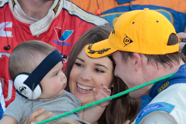 Mark Winterbottom with wife Renee and son Oliver after winning the Armor All Gold Coast 600, event 11 of the 2011 Australian V8 Supercar Championship Series at the Gold Coast Street Circuit, Gold Coast, Queensland, October 23, 2011.