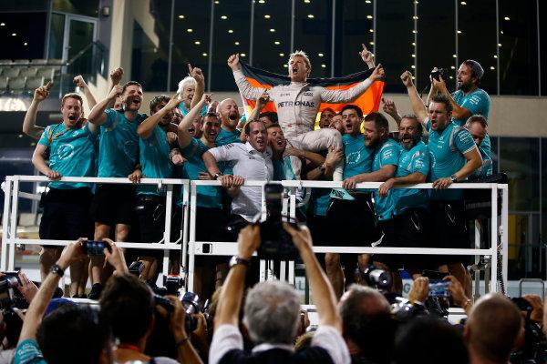 Yas Marina Circuit, Abu Dhabi, United Arab Emirates. Sunday 27 November 2016. Nico Rosberg, Mercedes AMG, 2nd Position and new World Champion, celebrates with his team, friends and family. World Copyright: Andrew Hone/LAT Photographic ref: Digital Image _ONY8288