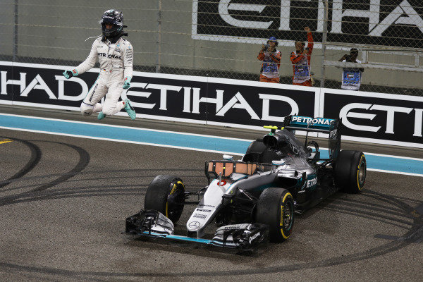Nico Rosberg, Mercedes F1 W07 Hybrid, celebrates as he jumps from his car after winning the World Championship.