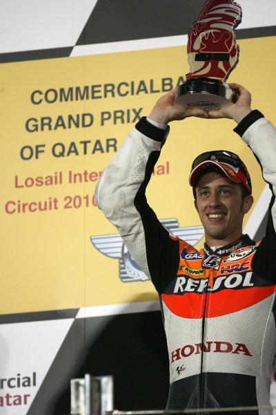 Losail International Circuit, Qatar.Round 1. 9th - 11th April 2010. Andrea Dovizioso celebrates his 3rd place.World Copyright: Martin Heath/LAT Photographicref: Digital Image SE5K6737