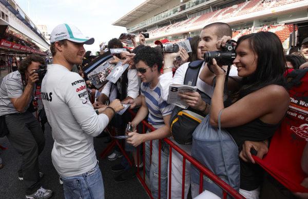 Circuit de Catalunya, Barcelona, Spain 19th May 2011 Nico Rosberg, Mercedes GP W02, signs autographs for fans. Portrait. Atmosphere.  World Copyright: Steve Etherington/LAT Photographic ref: Digital Image SNE23837