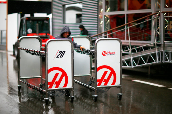 Circuit de Catalunya, Barcelona, Spain. Thursday 11 May 2017. Haas team members prepare equipment in a wet paddock. World Copyright: Andy Hone/LAT Images ref: Digital Image _ONY2894