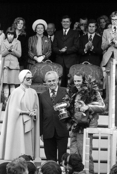 (L to R): HSH Princess Grace and HSH Prince Rainier with race winner Niki Lauda (AUT) Ferrari, on the podium.Monaco Grand Prix, Rd 5, Monte Carlo, Monaco, 11 May 1975.