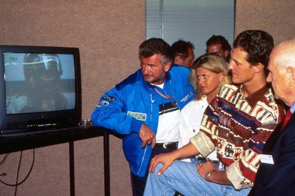 (L-R) Willi Weber (GER) Driver manager, Corinna Schumacher (GER) and Michael Schumacher (GER) Benetton, watch 1994 championship rival Damon Hill (GBR), Williams, on television. Australian Grand Prix, Adelaide, Australia, 13 November 1994.