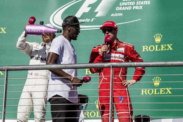 Race winner Lewis Hamilton (GBR) Mercedes AMG F1 celebrates on the podium with the champagne and Usain Bolt (JAM) alongside Kimi Raikkonen (FIN) Ferrari at Formula One World Championship, Rd17, United States Grand Prix, Race, Circuit of the Americas, Austin, Texas, USA, Sunday 22 October 2017.