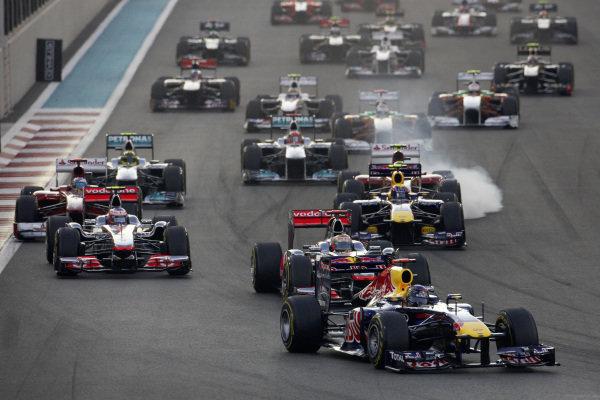 Sebastian Vettel, Red Bull RB7 Renault, leads Lewis Hamilton, McLaren MP4-26 Mercedes, Jenson Button, McLaren MP4-26 Mercedes, Mark Webber, Red Bull RB7 Renault, Fernando Alonso, Ferrari 150° Italia, and Felipe Massa, Ferrari 150° Italia, who locks up.