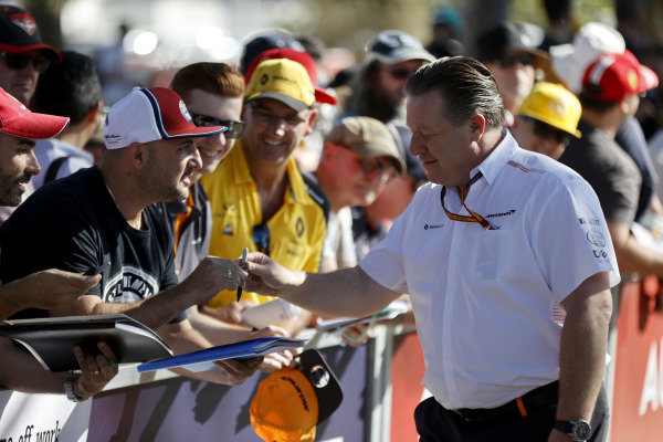 Zak Brown, Executive Director, McLaren signs autographs for fans.