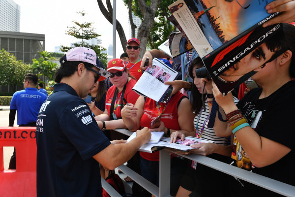 Sergio Perez, Racing Point Force India F1 Team signs autographs for the fans
