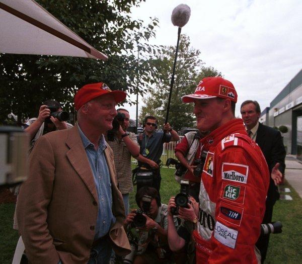 1999 Australian Grand Prix.Albert Park, Melbourne, Australia. 5-7 March 1999.Michael Schumacher (Ferrari) talks with Niki Lauda.World Copyright - Steve Etherington/LAT Photographic