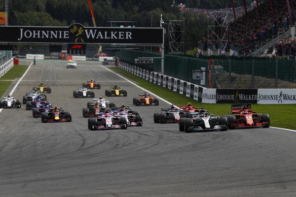 Lewis Hamilton, Mercedes AMG F1 W09, leads Sebastian Vettel, Ferrari SF71H, Esteban Ocon, Racing Point Force India VJM1, Sergio Perez, Racing Point Force India VJM11, Romain Grosjean, Haas F1 Team VF-18, and Kimi Raikkonen, Ferrari SF71H, at the start.