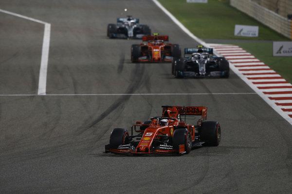 Sebastian Vettel, Ferrari SF90, leads Valtteri Bottas, Mercedes AMG W10, Charles Leclerc, Ferrari SF90, and Lewis Hamilton, Mercedes AMG F1 W10