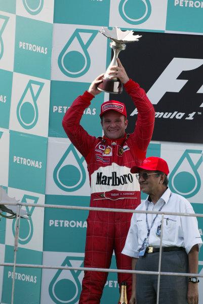 2003 Malaysian Grand Prix. Sepang, Kuala Lumpur, Malaysia.21-23 March 2003.Rubens Barrichello (Ferrari) celebrates his 2nd position on the podium.World Copyright - Steve Etherington/LAT Photographic ref: Digital Image Only